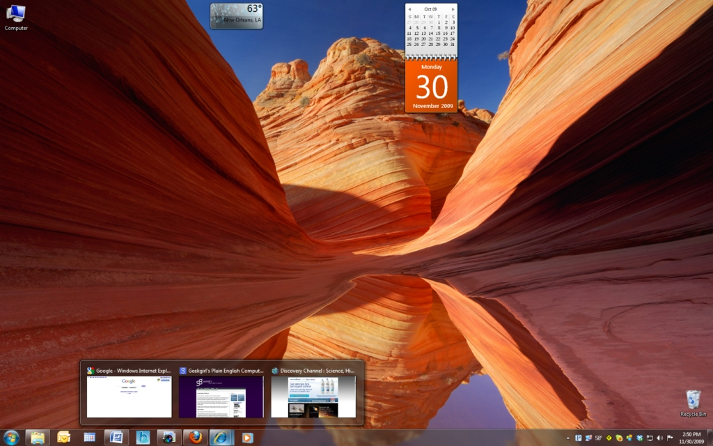 A revamped taskbar, sidebar-less gadgets, program previews and a beautiful collection of desktop themes on a Windows 7 desktop.
